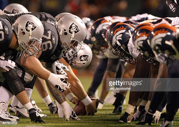 The Denver Broncos defense line up against the Oakland Raiders offense during the NFL game against the Oakland Raiders on September 8 2008 at McAfee...