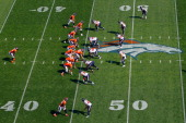 The Denver Broncos offense take to the line of scrimmage against the Houston Texans at Sports Authority Field at Mile High on September 23 2012 in...