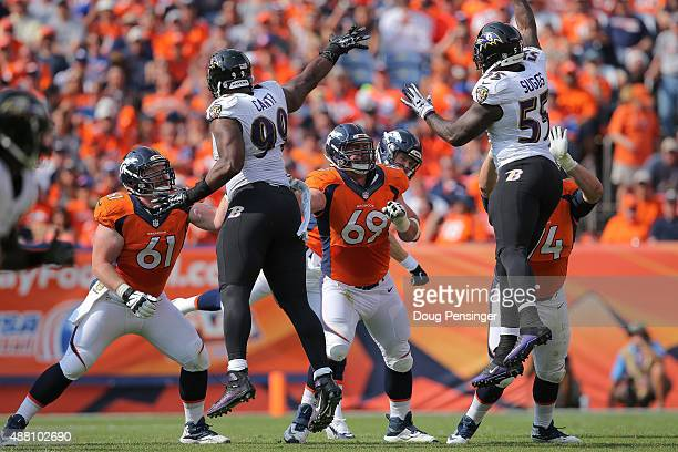 The Denver Broncos offensive line from left center Matt Paradis guard Evan Mathis and offensive tackle Ty Sambrailo block against defensive end Chris...