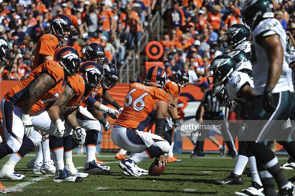 The Denver Broncos offensive line gets instructions from Peyton Manning in the first half. The Denver Broncos took on the Philadelphia Eagles at Sports Authority Field at Mile High in Denver on September 29, 2013.