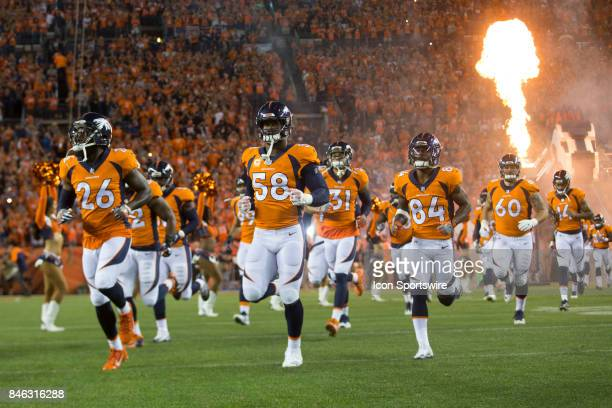 The Denver Broncos run onto the field during the Los Angeles Chargers vs Denver Broncos Monday Night Football game on September 11 at Sports...