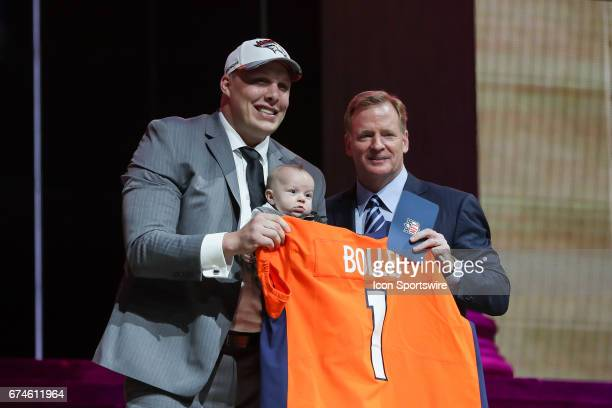 The Denver Broncos select Garett Bolles from Utah with the 20th pick at the 2017 NFL Draft holds his son Kingston and poses with NFL Commissioner...
