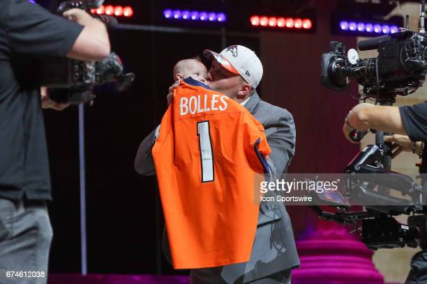 The Denver Broncos select Garett Bolles from Utah with the 20th pick at the 2017 NFL Draft holds his son Kingston at the NFL Draft Theater on April...