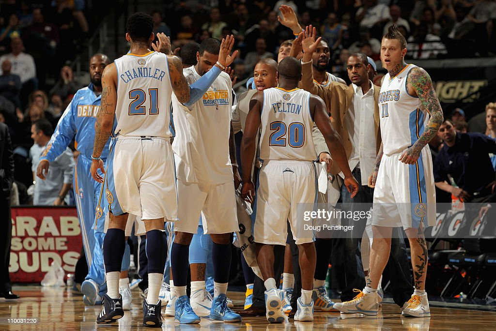 The Denver Nuggets celebrate as they head to the bench for a time out against the Detroit Pistons at the Pepsi Center on March 12, 2011 in Denver, Colorado. The Nuggets defeated the Pistons 131-101.