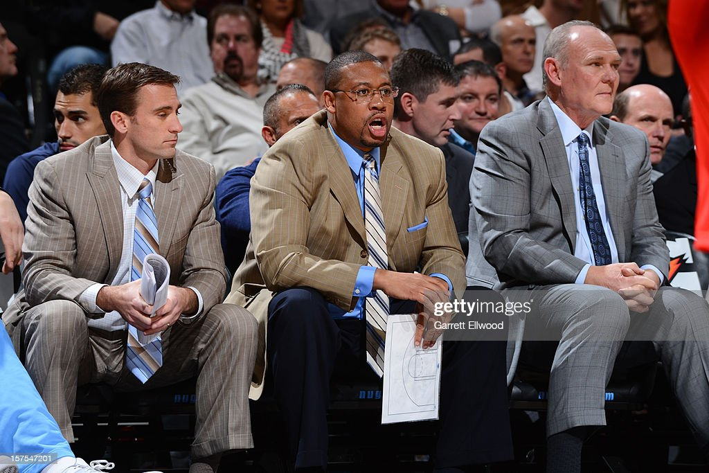 The Denver Nuggets coaching staff watches the game against the Milwaukee Bucks on December 3, 2012 at the Pepsi Center in Denver, Colorado.