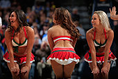 The Denver Nuggets Dancers perform in holiday costume as the Denver Nuggets host the Los Angeles Clippers at Pepsi Center on December 19 2014 in...