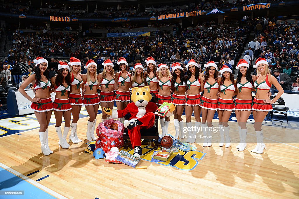 The Denver Nuggets dancers pose for a picture with their mascot Rocky the mountain lion before the game against the Golden State Warriors on November 23, 2012 at the Pepsi Center in Denver, Colorado.