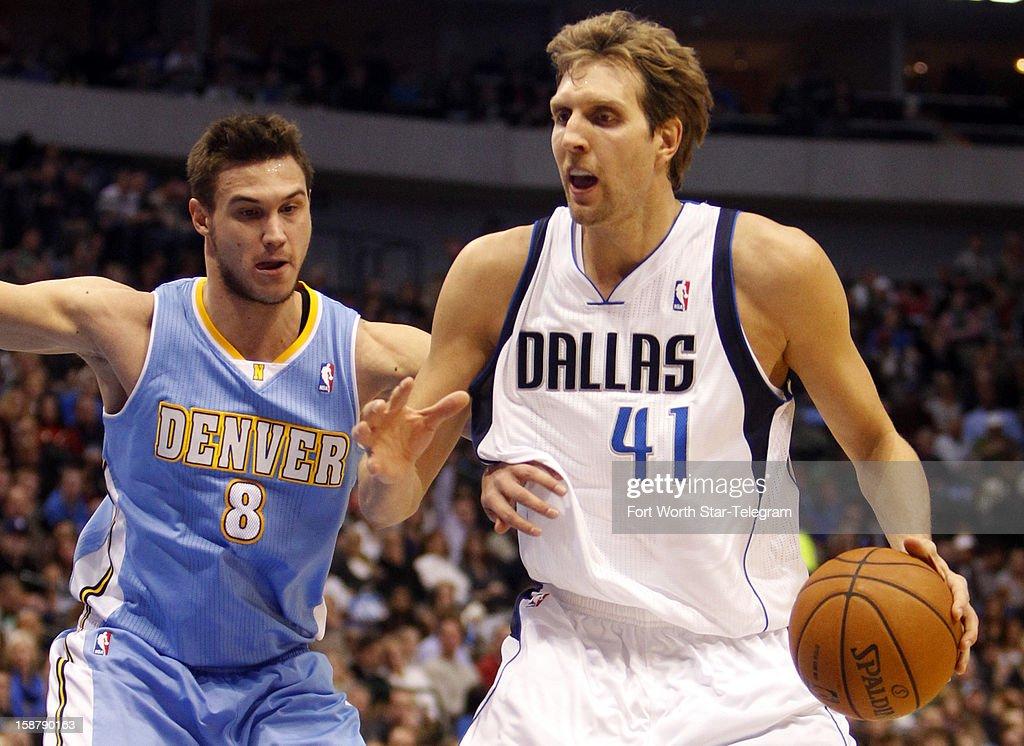 The Denver Nuggets' Danilo Gallinari (8) defends the Dallas Mavericks' Dirk Nowitzki at the American Airlines Center in Dallas, Texas, on Friday, December 28, 2012. Denver won, 106-85.