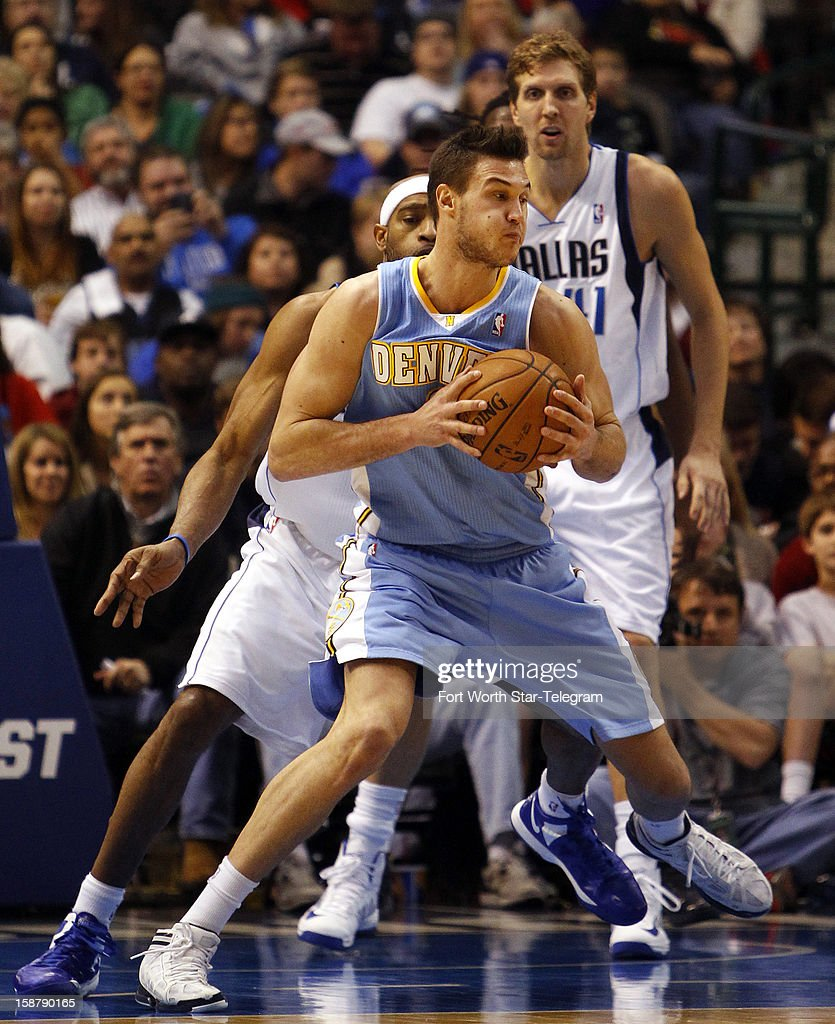 The Denver Nuggets' Danilo Gallinari works against the Dallas Mavericks' Dallas Mavericks' Vince Carter at the American Airlines Center in Dallas, Texas, on Friday, December 28, 2012. Denver won, 106-85.