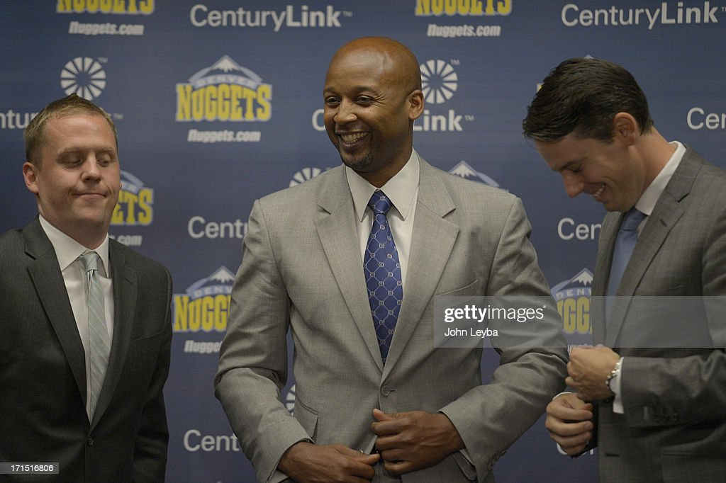The Denver Nuggets Executive VP of Basketball operations Tim Connelly (L) and President Josh Kroenke (R) prepare for a group photo with new head coach Brian Shaw June 25, 2013 during a press conference at Pepsi Center.
