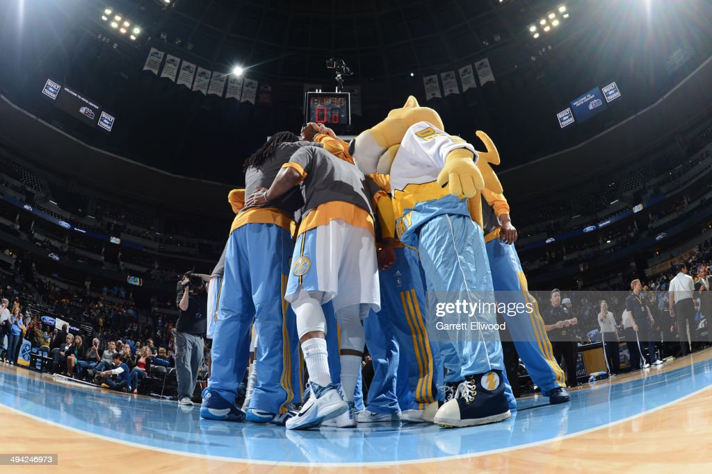 The Denver Nuggets huddle before the game against the Houston Rockets on April 9, 2014 at the Pepsi Center in Denver, Colorado.