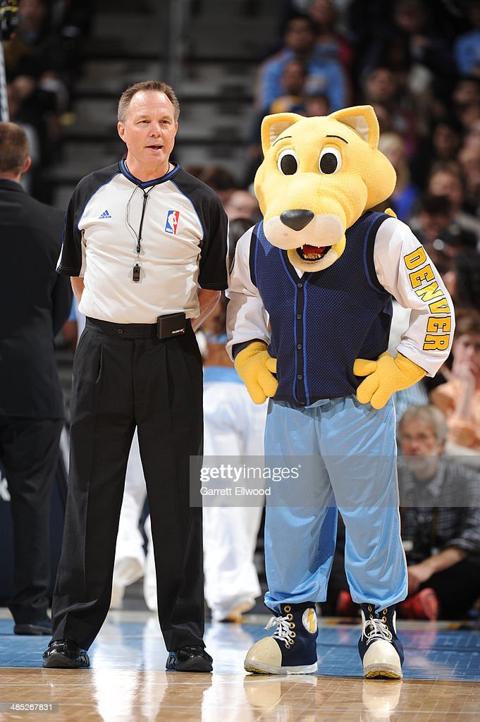 The Denver Nuggets mascot Rocky talks to an official during the game against the Golden State Warriors on April 16, 2014 at the Pepsi Center in Denver, Colorado.
