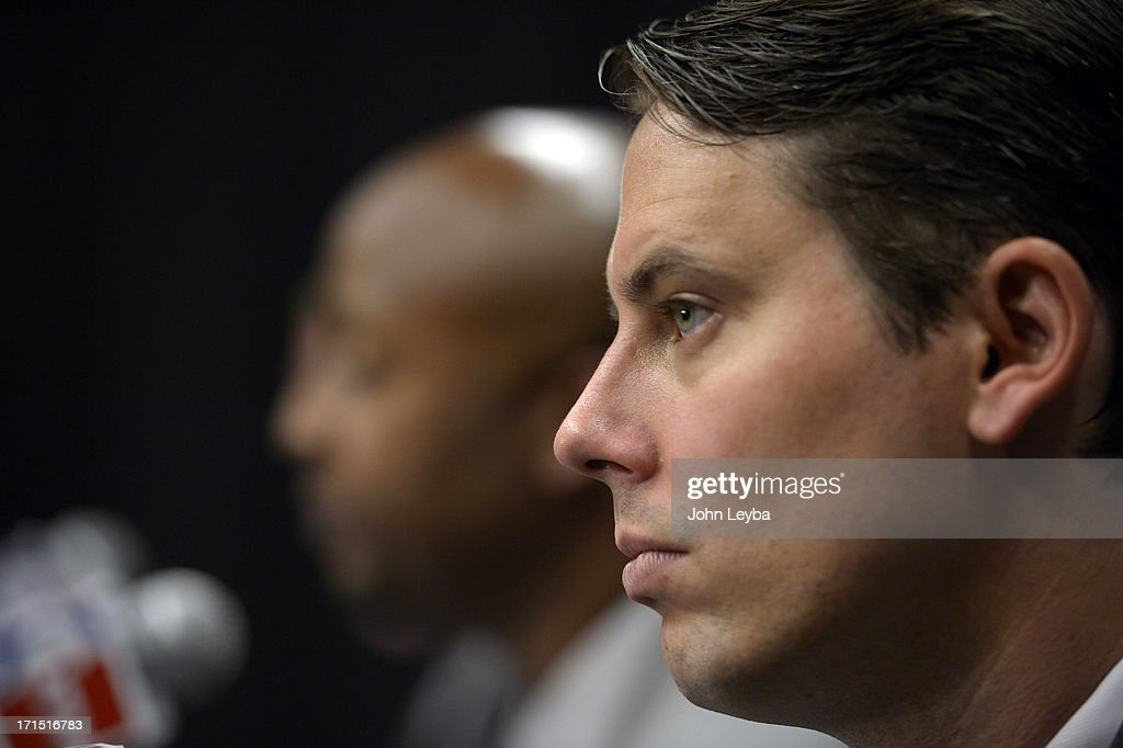 The Denver Nuggets President Josh Kroenke listens in to new head coach Brian Shaw June 25, 2013 during a press conference at Pepsi Center.
