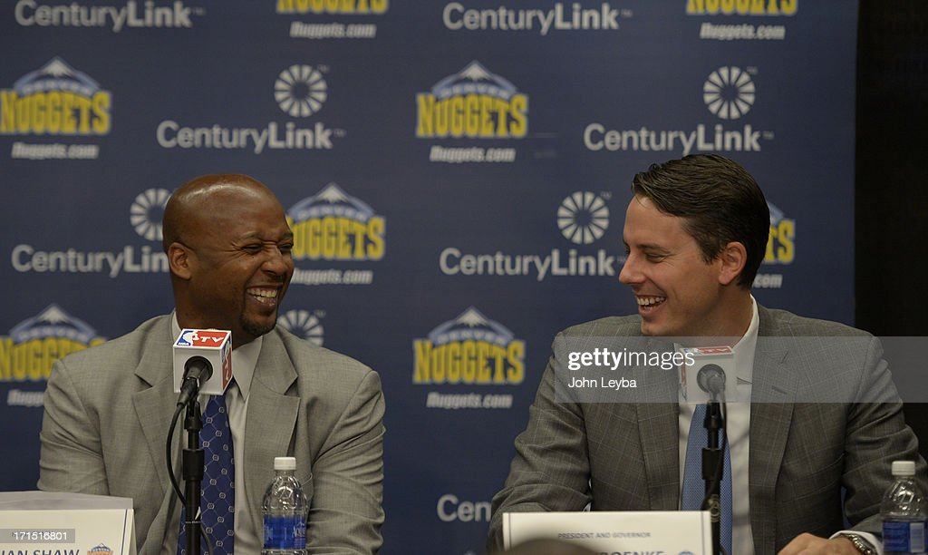 The Denver Nuggets President Josh Kroenke shares a laugh with new head coach Brian Shaw as they address the media June 25, 2013 during a press conference at Pepsi Center.