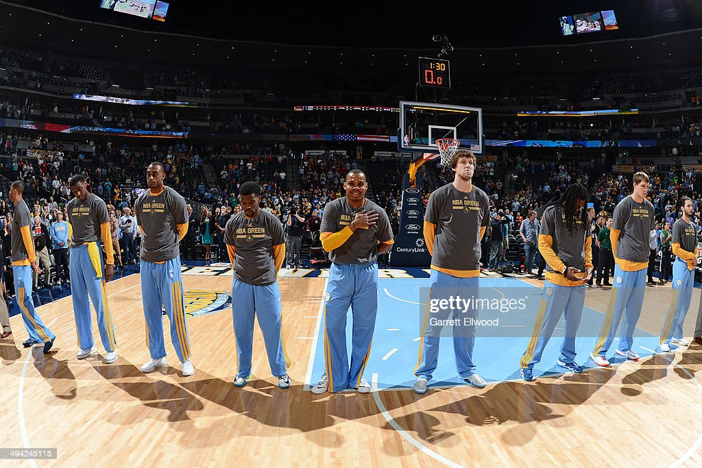 The Denver Nuggets stand during the National Anthem before the game against the Houston Rockets on April 9, 2014 at the Pepsi Center in Denver, Colorado.