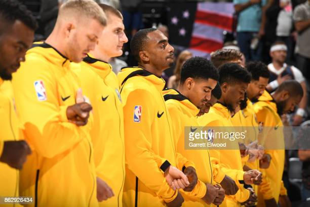 The Denver Nuggets stand for the National Anthem before the game against the Utah Jazz on October 18 2017 at vivintSmartHome Arena in Salt Lake City...