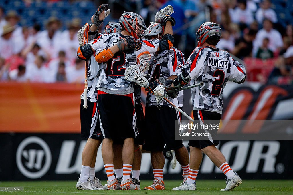 The Denver Outlaws celebrate a first quarter goal against the Ohio Machine at Sports Authority Field at Mile High on June 22, 2013 in Denver, Colorado.