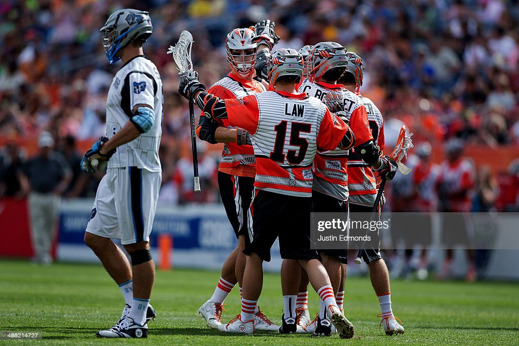 The Denver Outlaws celebrate a two-point goal by Jeremy Sieverts #20 (2nd L) during the third quarter against the Ohio Machine at Sports Authority Field at Mile High on May 4, 2014 in Denver, Colorado. The teams wore Star Wars themed jerseys in honor of 'May-The-4th-Be-With-You' day.The Outlaws defeated the Machine 14-12.