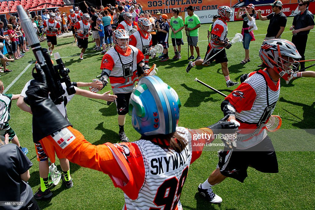 The Denver Outlaws take the field as a member of the Rebel Alliance cheers them on before a game against the Ohio Machine at Sports Authority Field at Mile High on May 4, 2014 in Denver, Colorado. The teams wore Star Wars themed jerseys in honor of 'May-The-4th-Be-With-You day.'