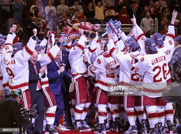 The Denver Pioneers celebrate after beating the MinnesotaDuluth Bulldogs during the 2017 NCAA Division I Men's Ice Hockey Championship game at the...