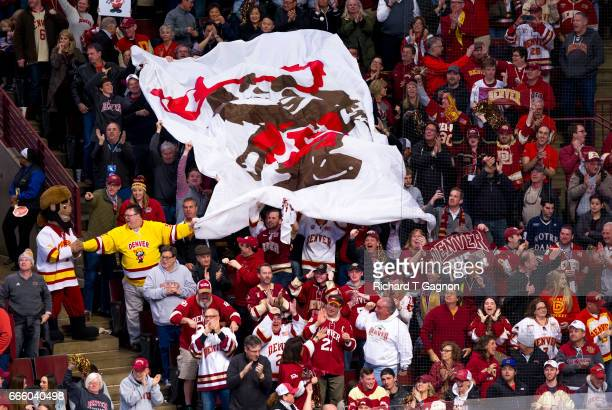 The Denver Pioneers hockey fans wave a giant mascot banner during a game against the Notre Dame Fighting Irish in game two of the 2017 NCAA Division...