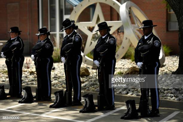 The Denver Sheriff Department Honor Guard stand for each member being honored during the memorial ceremony for officers who have died in the line of...