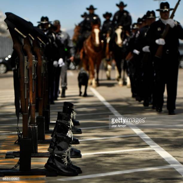 The Denver Sheriff's Honor Guard start the Department's memorial ceremony for officers who have died in the line of duty at the Denver County Jail...