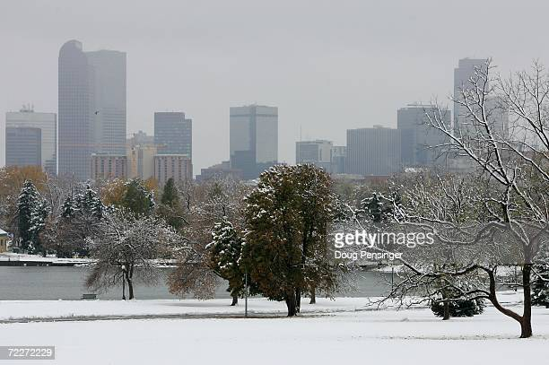 The Denver skyline emerges behind a snow blanketed Denver City Park after an early season snowstorm October 26 2006 in Denver Colorado The autumn...