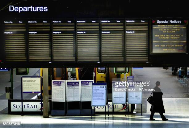 The departure board at Edinburgh`s Waverly station stands empty of destinations as commuters faced the first day of a wave of train strikes across...