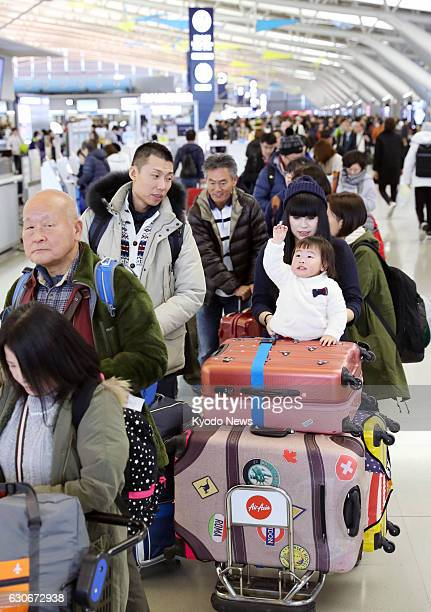 The departure lobby of Kansai International Airport in Osaka Prefecture is crowded by travelers on Dec 29 the first day of the yearend and New Year...