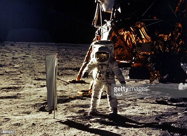 The deployment of scientific experiments by Astronaut Edwin Aldrin Jr is photographed by Astronaut Neil Armstrong Man's first landing on the Moon...