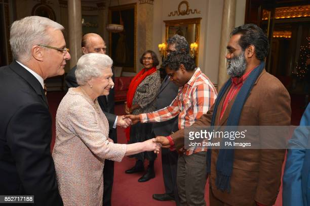 The Deputy Australian High Commissioner Andrew Todd introduces Queen Elizabeth II and Duke of Edinburgh to family members of the Aboriginal artist...