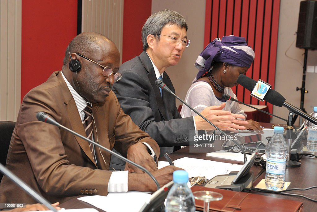 The Deputy Managing Director of the International Monetary Fund (IMF), Zhu Min (C), speaks as he attends a press conference, as part of a symposium on the economy of Senegal, alongside former Senegalese Prime Minister Mamadou Lamine Loum (L) and scholar Fatou Sarr Sow (R), in Dakar, on November 6, 2012. Zhu Min is the first Chinese national to hold the post of Deputy Managing Director at the IMF and is in Senegal to discuss with leaders and academics about the economic prospects of the country. Meanwhile Senegalese President Macky Sall on November 5 denounced exorbitant interest rates in Africa at a conference marking the 50th anniversary of the West African central bank, state media reported.