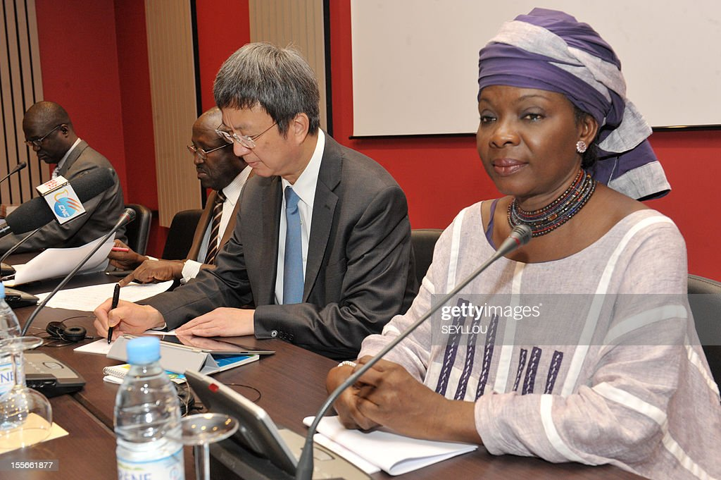 The Deputy Managing Director of the International Monetary Fund (IMF), Zhu Min (C), speaks as he attends a press conference, as part of a symposium on the economy of Senegal, alongside former Senegalese Prime Minister Mamadou Lamine Loum (2nd L) and scholar Fatou Sarr Sow (R), in Dakar, on November 6, 2012. Zhu Min is the first Chinese national to hold the post of Deputy Managing Director at the IMF and is in Senegal to discuss with leaders and academics about the economic prospects of the country. Meanwhile Senegalese President Macky Sall on November 5 denounced exorbitant interest rates in Africa at a conference marking the 50th anniversary of the West African central bank, state media reported.