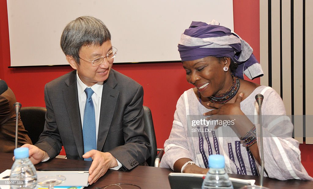 The Deputy Managing Director of the International Monetary Fund (IMF), Zhu Min (L), speaks as he attends a press conference, as part of a symposium on the economy of Senegal, with scholar Fatou Sarr Sow (R), in Dakar, on November 6, 2012. Zhu Min is the first Chinese national to hold the post of Deputy Managing Director at the IMF and is in Senegal to discuss with leaders and academics about the economic prospects of the country. Meanwhile Senegalese President Macky Sall on November 5 denounced exorbitant interest rates in Africa at a conference marking the 50th anniversary of the West African central bank, state media reported.