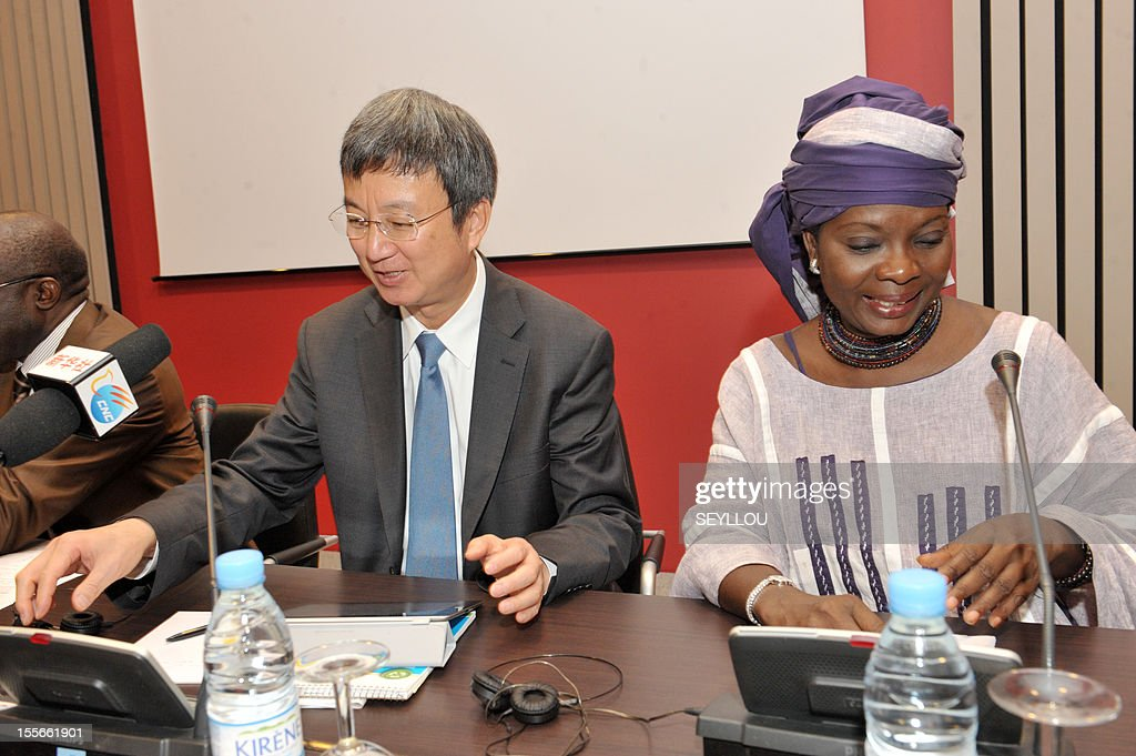 The Deputy Managing Director of the International Monetary Fund (IMF), Zhu Min (L), speaks as he attends a press conference, as part of a symposium on the economy of Senegal, alongside scholar Fatou Sarr Sow (R), in Dakar, on November 6, 2012. Zhu Min is the first Chinese national to hold the post of Deputy Managing Director at the IMF and is in Senegal to discuss with leaders and academics about the economic prospects of the country. Meanwhile Senegalese President Macky Sall on November 5 denounced exorbitant interest rates in Africa at a conference marking the 50th anniversary of the West African central bank, state media reported. AFP PHOTO / SEYLLOU
