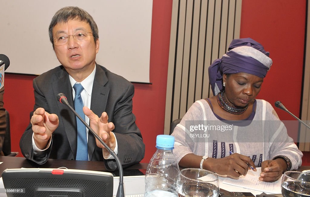 The Deputy Managing Director of the International Monetary Fund (IMF), Zhu Min (L), speaks as he attends a press conference, as part of a symposium on the economy of Senegal, alongside scholar Fatou Sarr Sow (R), in Dakar, on November 6, 2012. Zhu Min is the first Chinese national to hold the post of Deputy Managing Director at the IMF and is in Senegal to discuss with leaders and academics about the economic prospects of the country. Meanwhile Senegalese President Macky Sall on November 5 denounced exorbitant interest rates in Africa at a conference marking the 50th anniversary of the West African central bank, state media reported.