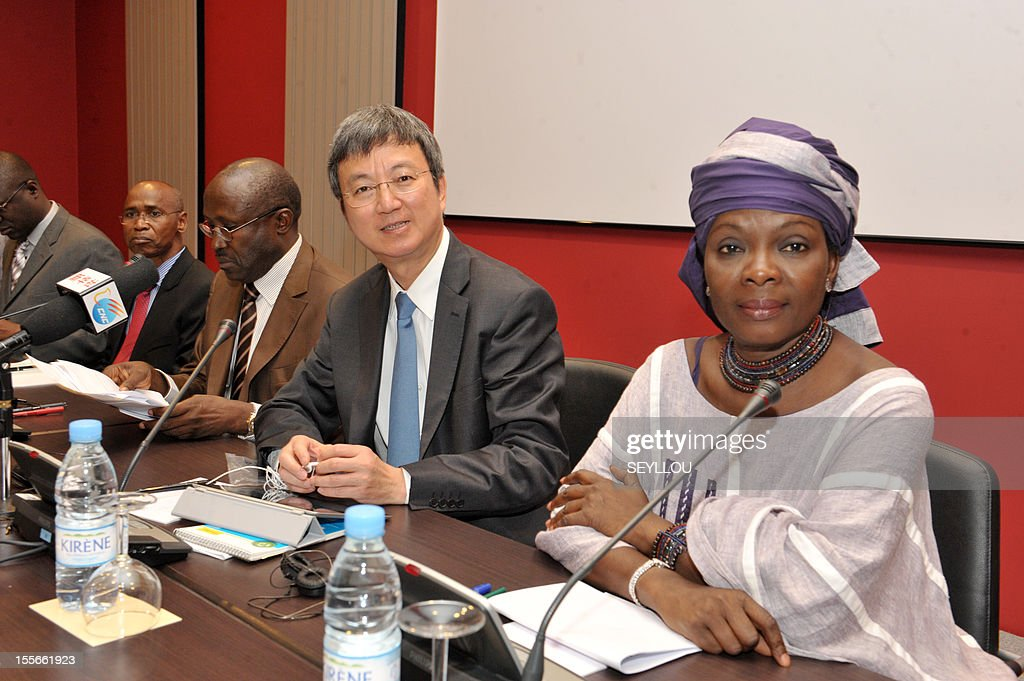 The Deputy Managing Director of the International Monetary Fund (IMF), Zhu Min (C), looks on as he attends a press conference, as part of a symposium on the economy of Senegal, alongside former Senegalese Prime Minister Mamadou Lamine Loum (3rd L) and scholar Fatou Sarr Sow (R), in Dakar, on November 6, 2012. Zhu Min is the first Chinese national to hold the post of Deputy Managing Director at the IMF and is in Senegal to discuss with leaders and academics about the economic prospects of the country. Meanwhile Senegalese President Macky Sall on November 5 denounced exorbitant interest rates in Africa at a conference marking the 50th anniversary of the West African central bank, state media reported.
