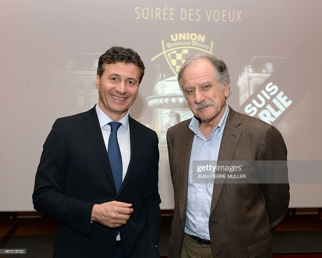 The deputy mayor of the southwestern French city of Begles, <a gi-track='captionPersonalityLinkClicked' href=/galleries/search?phrase=Noel+Mamere&family=editorial&specificpeople=686128 ng-click='$event.stopPropagation()'>Noel Mamere</a> (R), poses on January 8, 2015 with the president of the Top 14 rugby club Union Begles Bordeaux, Laurent Marti, in the southwestern French city of Bordeaux.
