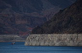 The Desert Princess paddle wheeler passes by a tall bleached 'bathtub ring' on the rocky banks of Lake Mead near the Lake Mead Marina on May 12 2015...