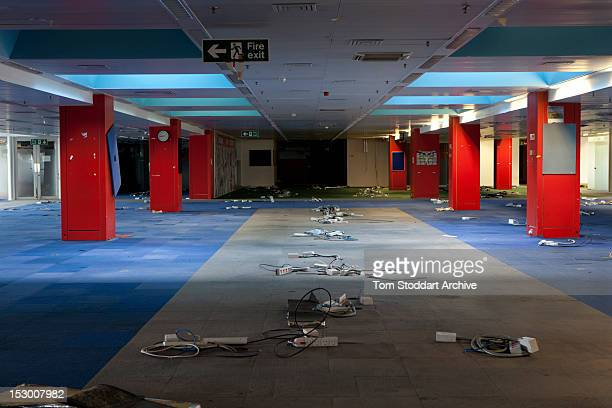 The deserted interior of the Sun newsroom inside the former News International base in Wapping East London Media mogul Rupert Murdoch moved his...