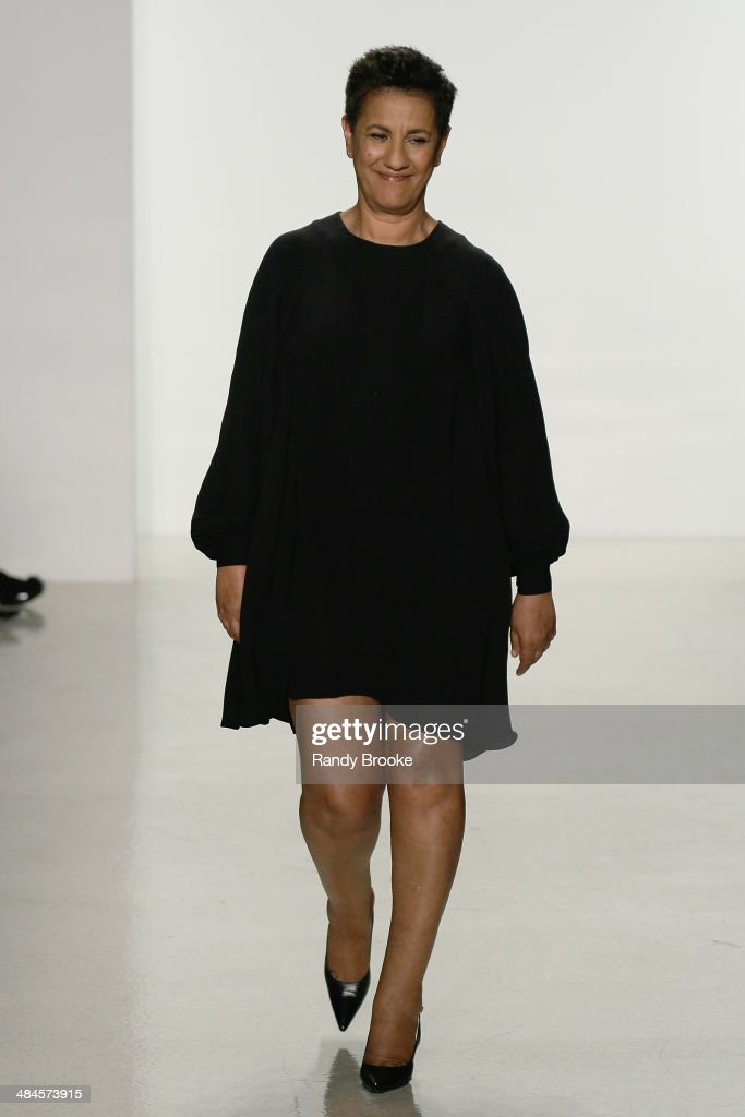 The designer Amsale greets the audience on the runway at the conclusion of the Amsale Spring 2015 Bridal collection show at EZ Studios on April 12, 2014 in New York City.