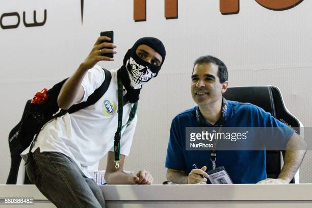 The designer and producer of electronic games Ed Boon participates in an autograph session with fans during the 10th edition of Brazil Game Show in...