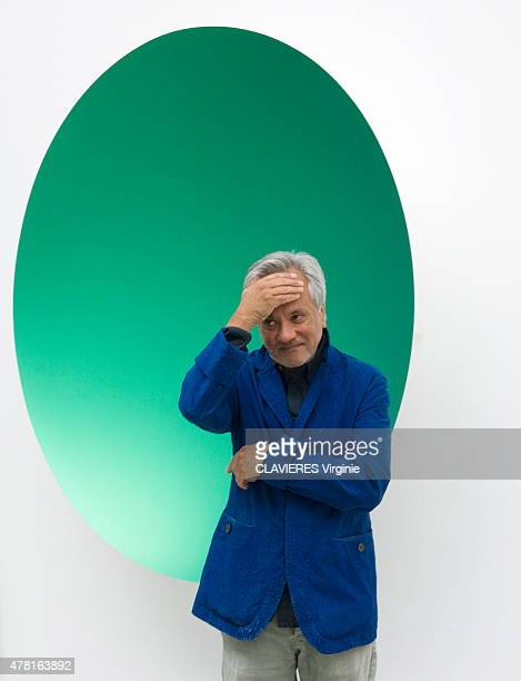 the designer Anish Kapoor poses with his sculpture in fiber glass 2012 on april 27 2015 in London United Kingdom