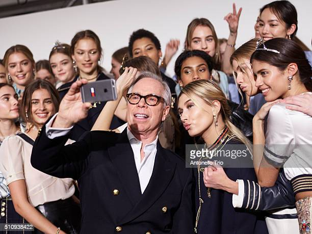 The designer Tommy Hilfiger poses with models backstage at the Tommy Hilfiger Women's Fall 2016 show during New York Fashion Week The Shows at Park...