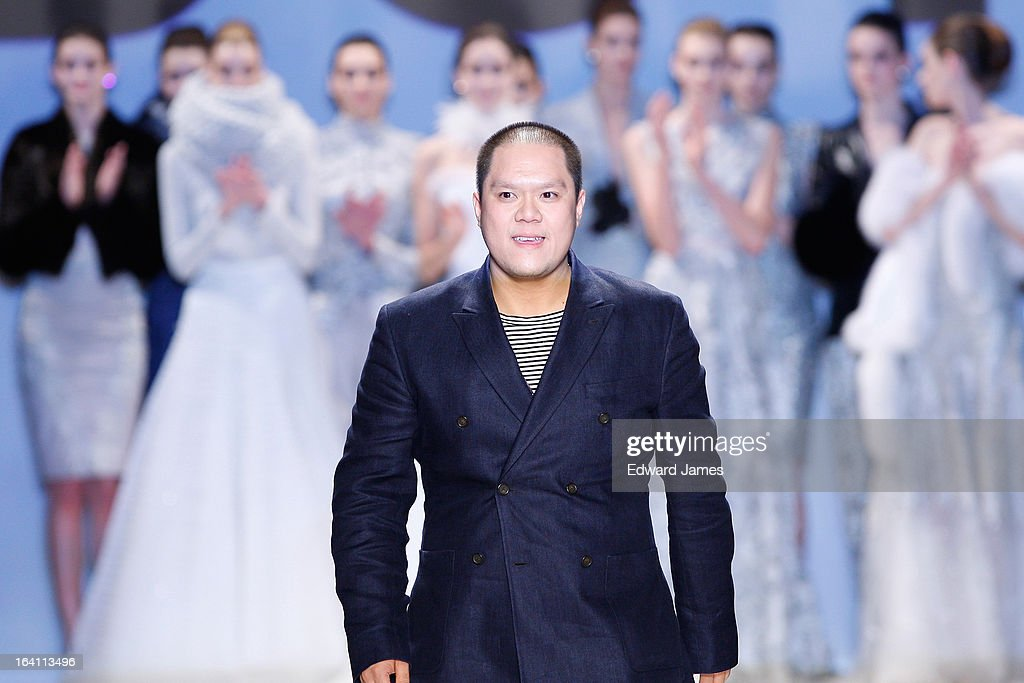 The designer walks the runway during Duy at David Pecaut Square on March 19, 2013 in Toronto, Canada.