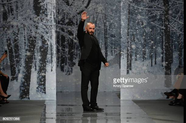 The designer Ziad Nakad greets the public at the end of the the Maison Ziad Nakad Haute Couture Fall/Winter 20172018 show as part of Haute Couture...