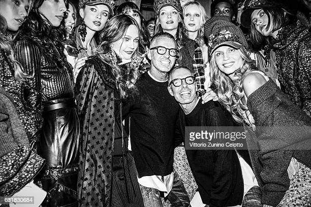 The designers Dean and Dan are seen backstage with models after the Dsquared2 show during Milan Men's Fashion Week Fall/Winter 2017/18 on January 15...