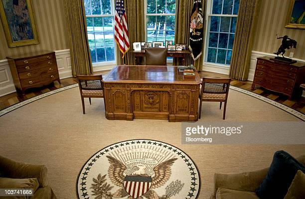 The desk of President Barack Obama sits on top of a new rug in the Oval Office at the White House in Washington DC US on Tuesday Aug 31 2010 Obama...