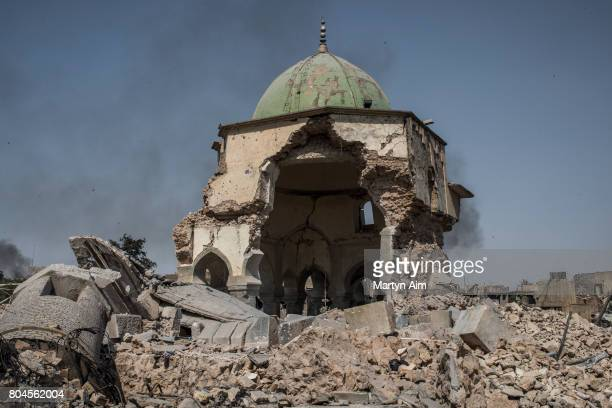 The destroyed alNuri mosque in the Old City of west Mosul where heavy fighting continues on June 30 2017 in Mosul Iraq Iraqi forces continue to...